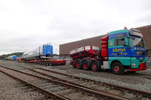 Loading railway carriages onto the special trailer with its built-in railway tracks