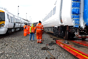 Unloading work being carried out using the temporary ramp for when on the rails